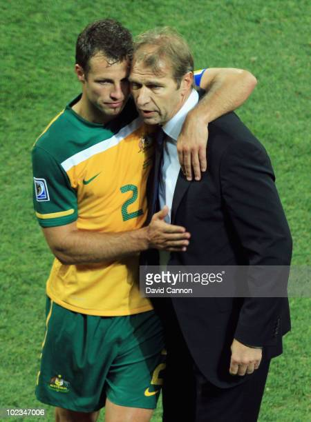 Pim Verbeek head coach of Australia hugs Lucas Neill after victory in the game but elimination from the tournament in the 2010 FIFA World Cup South...