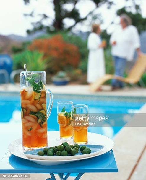 Pimm's Cup cocktails on tray by pool