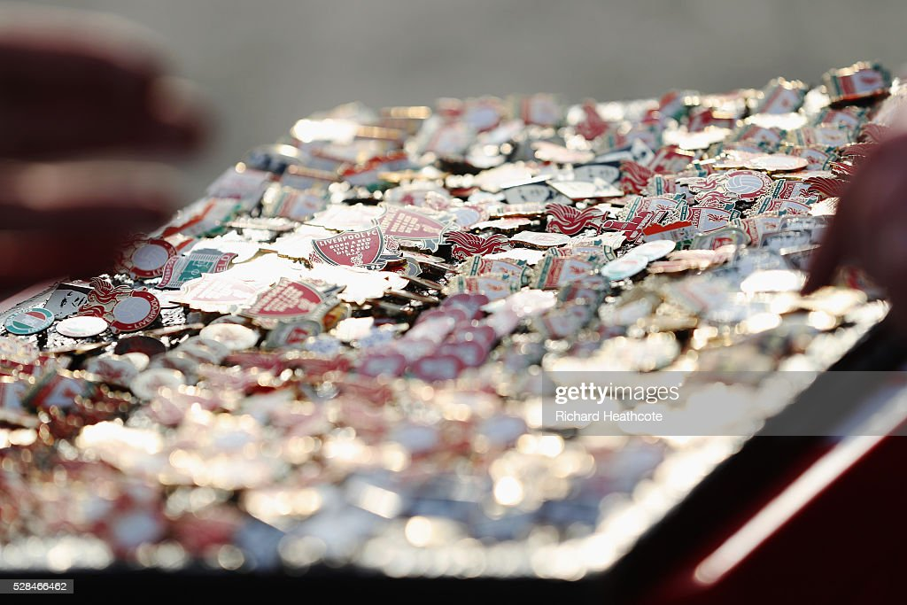 Pin badges for sale prior to the UEFA Europa League semi final second leg match between Liverpool and Villarreal CF at Anfield on May 5, 2016 in Liverpool, England.