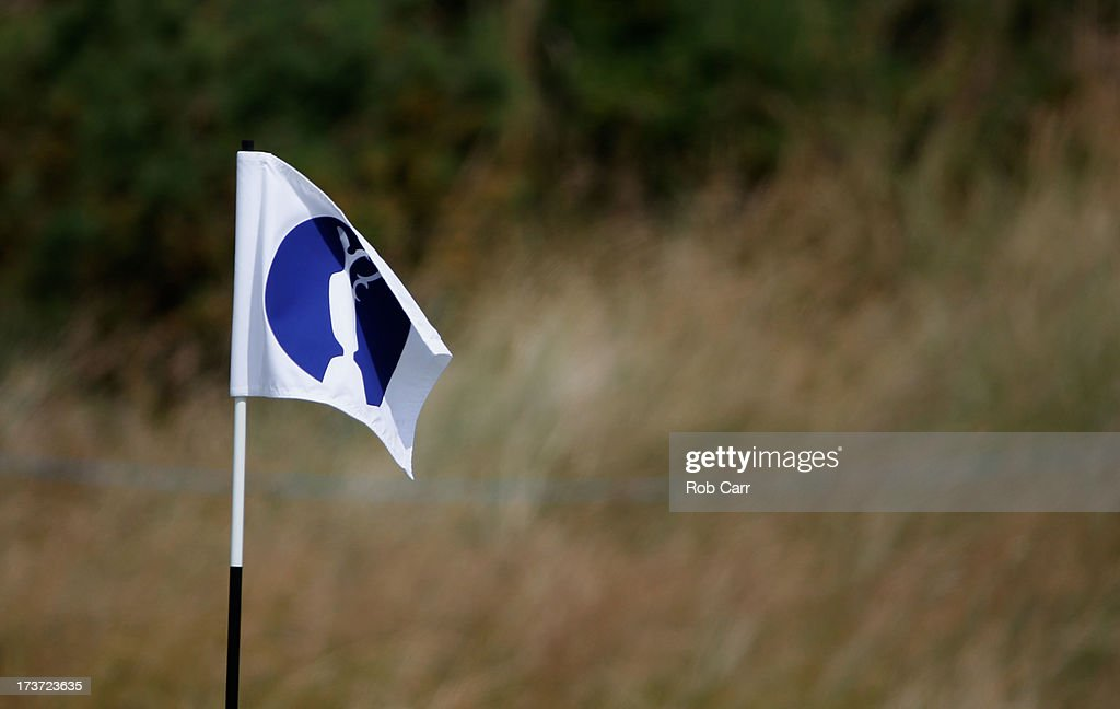 A pin flag flutters on the green ahead of the 142nd Open Championship at Muirfield on July 17, 2013 in Gullane, Scotland.