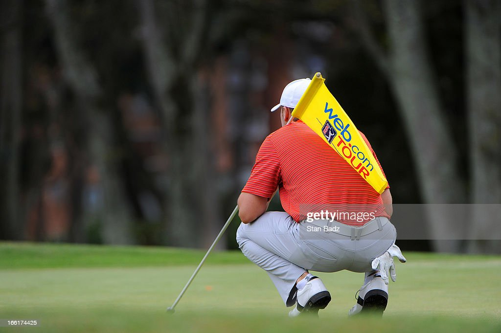 A pin flag is supported by a player on the 11th hole during the third round of the Colombia Championship at Country Club de Bogota on March 2, 2013 in Bogota, Colombia.