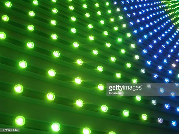 Pin lights in blue and green surface