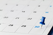 Pin on calendar on  30th of the month, business concept