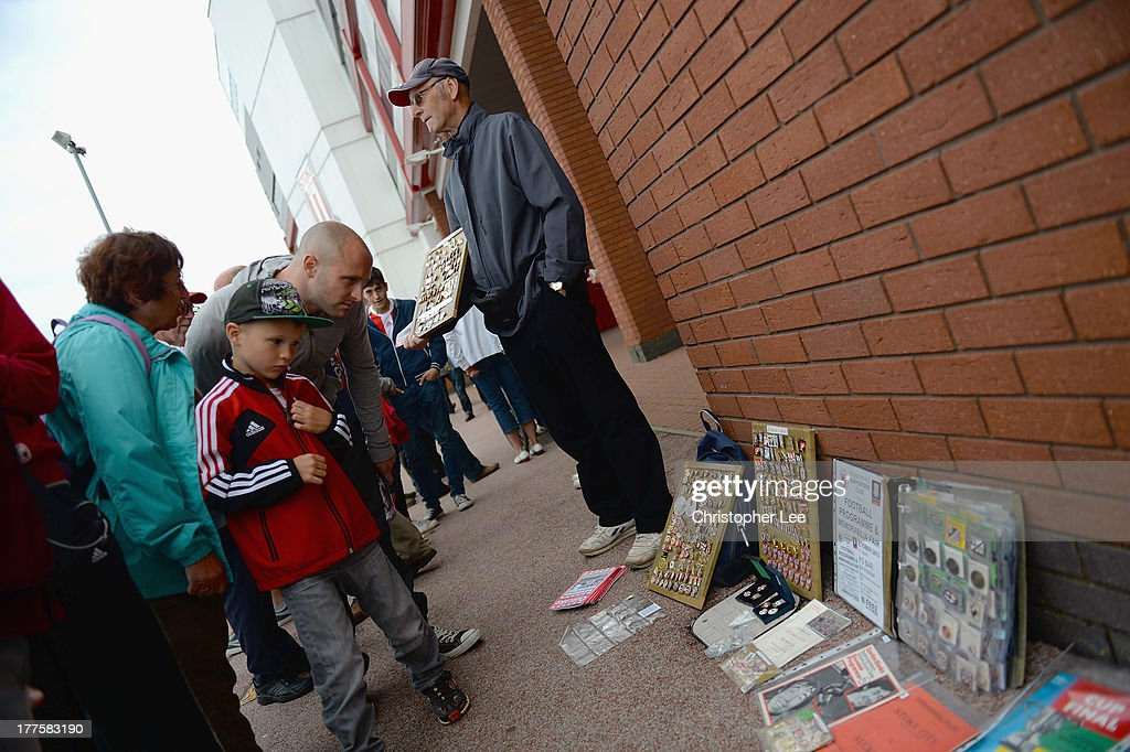 A Pin seller outside the Britannia Stadium during the Barclays Premier League match between Stoke City and Crystal Palace at Britannia Stadium on August 24, 2013 in Stoke on Trent, England.