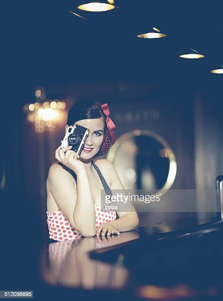 pin up girl with camera in a night club
