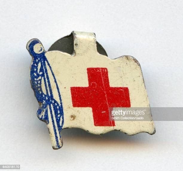 Pin with flag in red white and blue bearing the symbol of the American Red Cross 1940