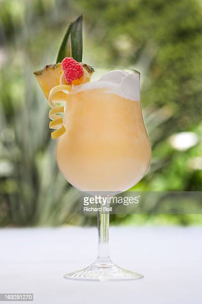 A pina colada cocktail on a white table cloth