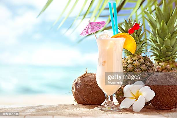 Pina Colada cocktail on the beach with copy space
