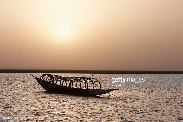Pinasse in the sunset over Lake Debo formed by the seasonal flooding of the Niger River Mali