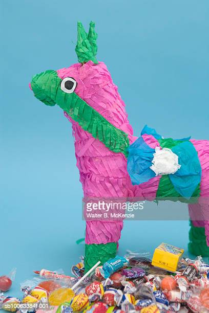 Pinata horse with scattered candies, side view, studio shot