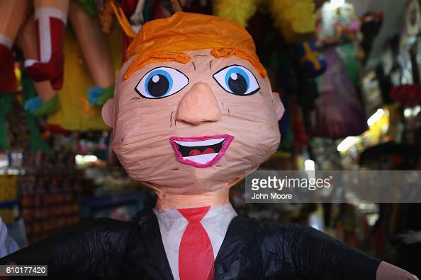 A pinata of Republican Presidential candidate Donald Trump stands for sale in a market on September 24 2016 in Tijuana Mexico The candidate who's...