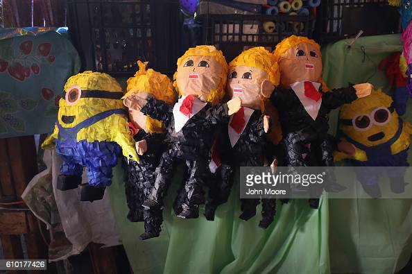 Pinatas of Republican Presidential candidate Donald Trump stand for sale in a market on September 24 2016 in Tijuana Mexico The candidate who's...