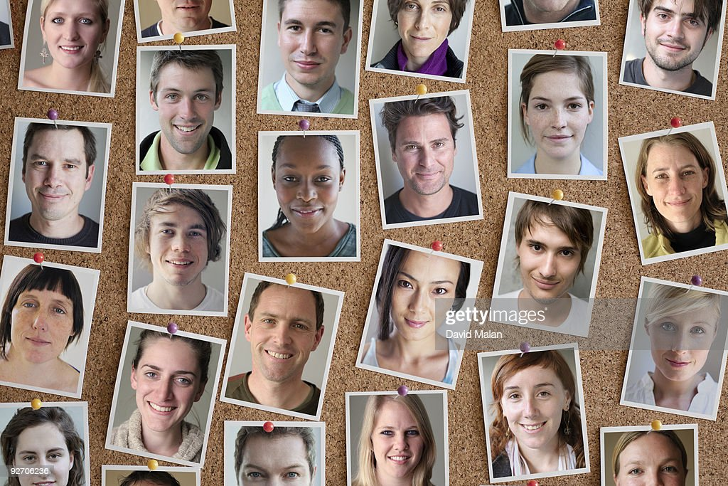 Pinboard with many portraits : Stock Photo