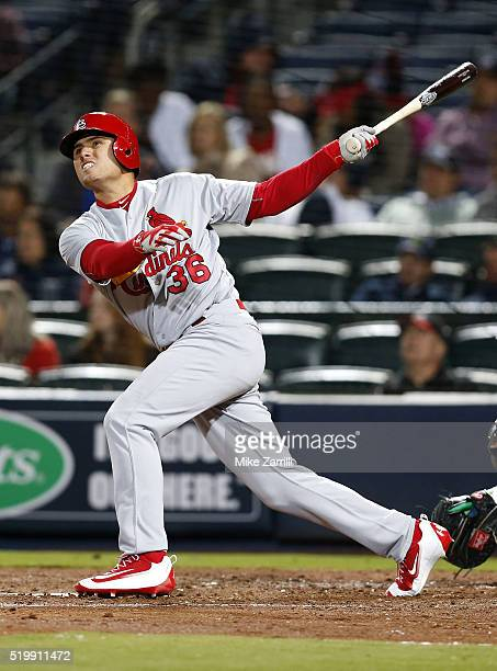 Pinch hitter Aledmys Diaz of the St Louis Cardinals hits a goahead home run in the eighth inning during the game against the Atlanta Braves at Turner...