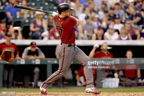 Pinch hitter Brandon Drury of the Arizona Diamondbacks hits a RBI in the eighth inning against the Colorado Rockeis at Coors Field on May 7 2017 in...