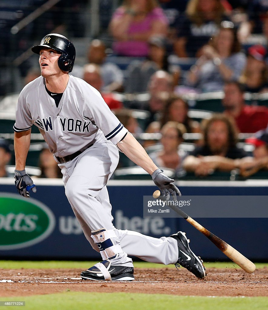 Pinch hitter Brendan Ryan of the New York Yankees hits a double in the ninth inning during the game against the Atlanta Braves at Turner Field on...