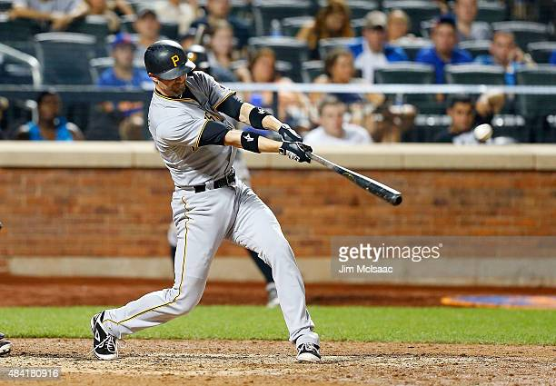 Pinch hitter Chris Stewart of the Pittsburgh Pirates connects on a 14th inning RBI base hit against the New York Mets at Citi Field on August 15 2015...
