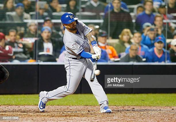 Pinch hitter Christian Colon of the Kansas City Royals connects on a 12th inning RBI base hit against the New York Mets during game five of the 2015...