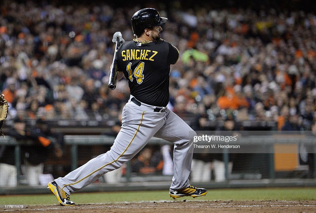 Pinch hitter <a gi-track='captionPersonalityLinkClicked' href=/galleries/search?phrase=Gaby+Sanchez&family=editorial&specificpeople=4945789 ng-click='$event.stopPropagation()'>Gaby Sanchez</a> #14 of the Pittsburgh Pirates hit an RBI single scoring Andrew McCutchen #22 in the sixth inning against the San Francisco Giants at AT&T Park on August 24, 2013 in San Francisco, California.