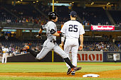 Pinch hitter Ichiro Suzuki of the Miami Marlins runs out a ninth inning infield base hit past Mark Teixeira of the New York Yankees at Yankee Stadium...