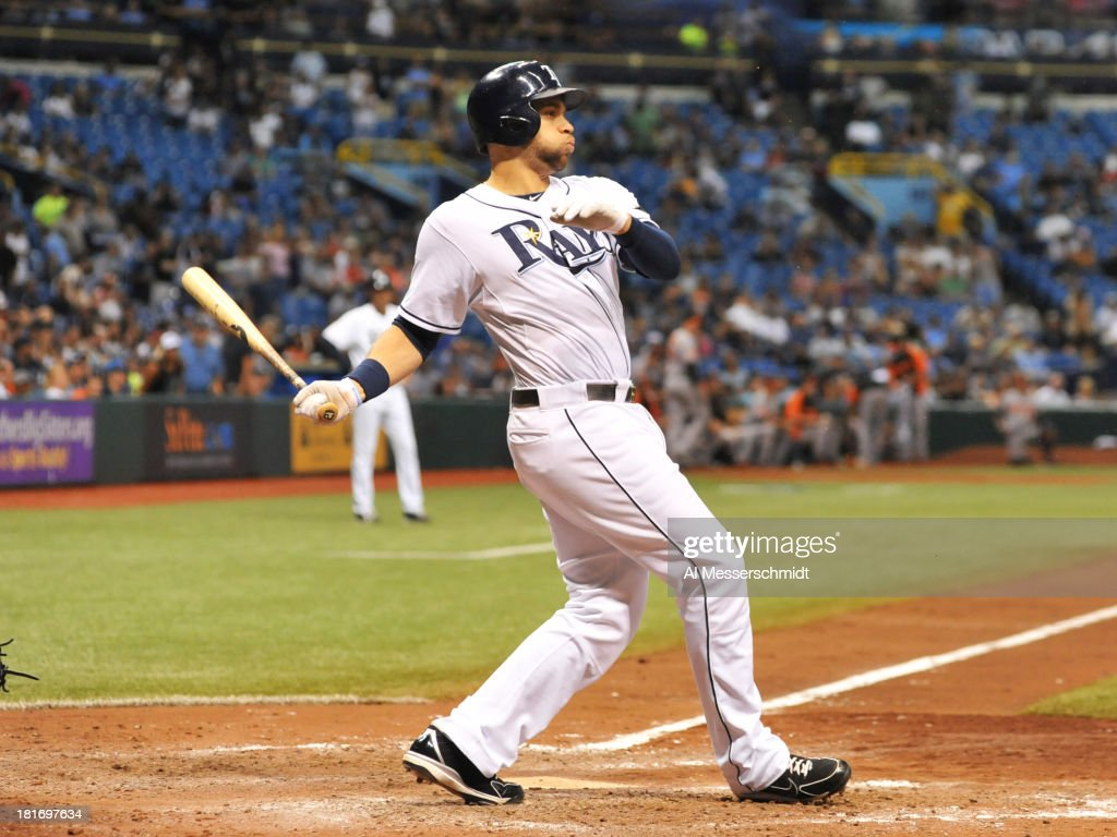 Pinch hitter James Loney #21 of the Tampa Bay Rays homers in the bottom of the 9th inning against the Baltimore Orioles September 23, 2013 at Tropicana Field in St. Petersburg, Florida. The Rays won 5 - 4.