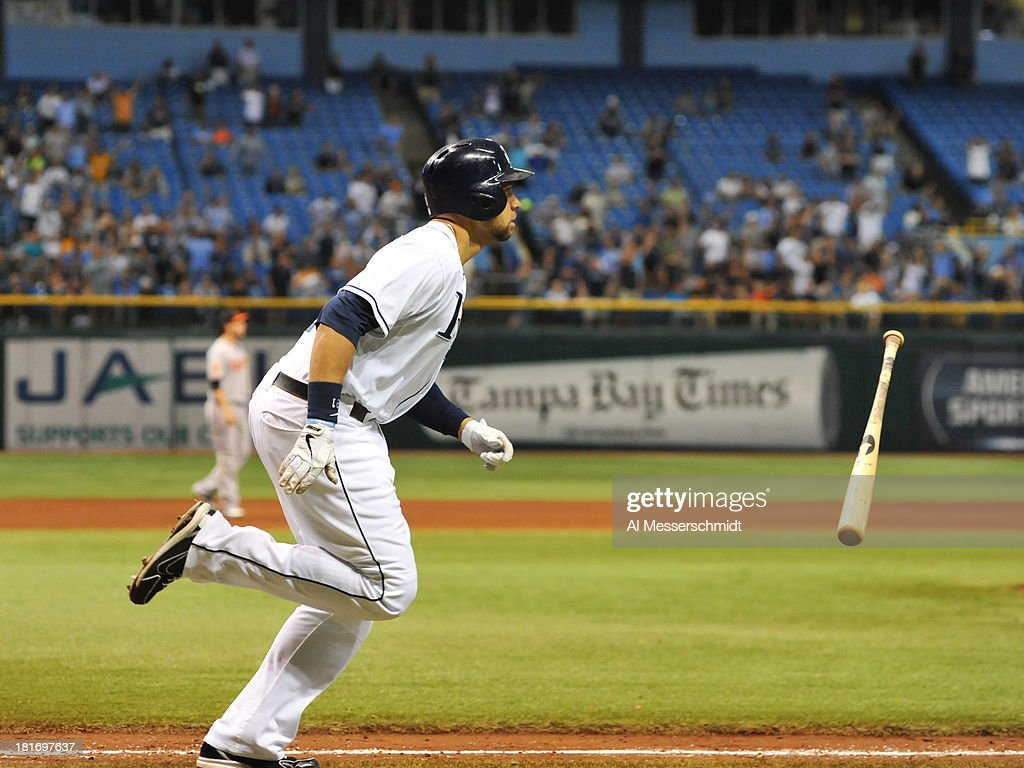 Pinch hitter <a gi-track='captionPersonalityLinkClicked' href=/galleries/search?phrase=James+Loney&family=editorial&specificpeople=636293 ng-click='$event.stopPropagation()'>James Loney</a> #21 of the Tampa Bay Rays runs to first base after a home run in the bottom of the 9th inning against the Baltimore Orioles September 23, 2013 at Tropicana Field in St. Petersburg, Florida. The Rays won 5 - 4.