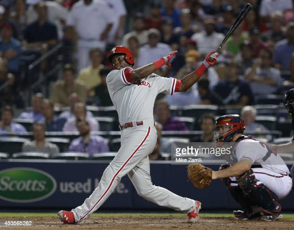 Pinch hitter John Mayberry Jr #15 of the Philadelphia Phillies follows through on a swing during the game against the Atlanta Braves at Turner Field...