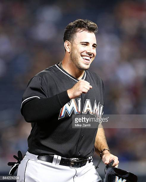 Pinch hitter Jose Fernandez of the Miami Marlins reacts after hitting a 2run goahead gamewinning double in the twelfth inning during the game against...