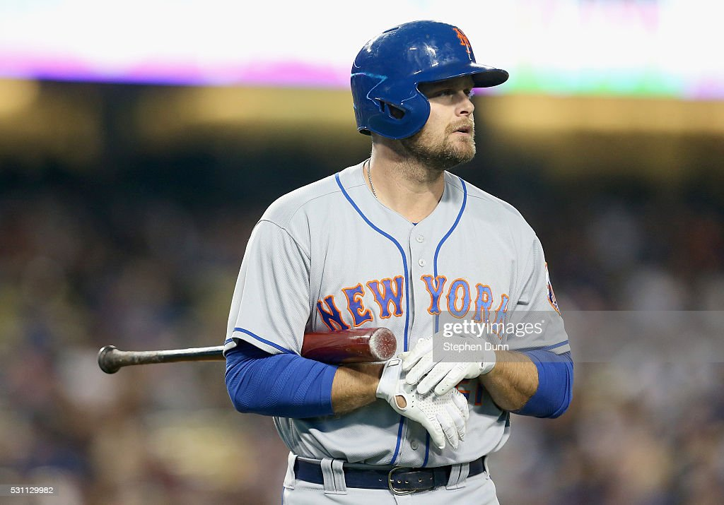 Pinch hitter Lucas Duda of the New York Mets walks back to the dugout after striking out for the first out of the ninth inning against Clayton...