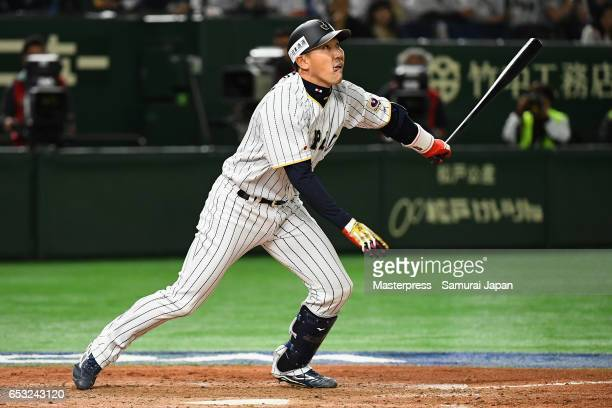 Pinch hitter Outfielder Seiichi Uchikawa of Japan hits a sacrifice fly to make it 56 in the bottom of the eighth inning during the World Baseball...