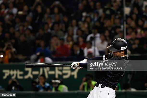 Pinch hitter Shohei Ohtani of Japan hits a double which is stuck on ceiling of the stadium in the seventh inning during the international friendly...