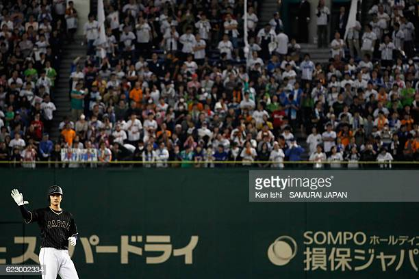 Pinch hitter Shohei Ohtani of Japan reacts after hitting a double which is stuck on ceiling of the stadium in the seventh inning during the...