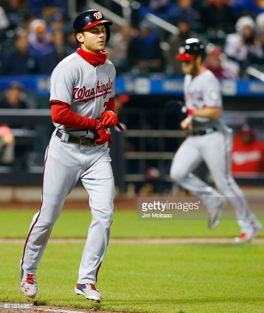Pinch hitter Trea Turner of the Washington Nationals draws a bases loaded walk in the eleventh inning against the New York Mets scoring teammate...