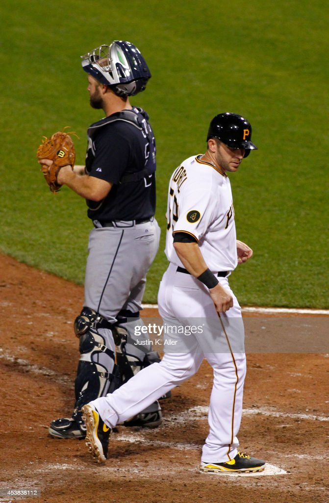 Pinch runner <a gi-track='captionPersonalityLinkClicked' href=/galleries/search?phrase=Brent+Morel&family=editorial&specificpeople=6796477 ng-click='$event.stopPropagation()'>Brent Morel</a> #59 of the Pittsburgh Pirates scores on a RBI single in the ninth inning against the Atlanta Braves during the game at PNC Park on August 19, 2014 in Pittsburgh, Pennsylvania.