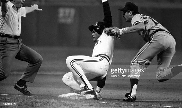 Pinch runner Carmelo Castillo of the Cleveland Indians slides safely into the base as thirdbaseman Wayne Krenchicki of the Detroit Tigers applies the...