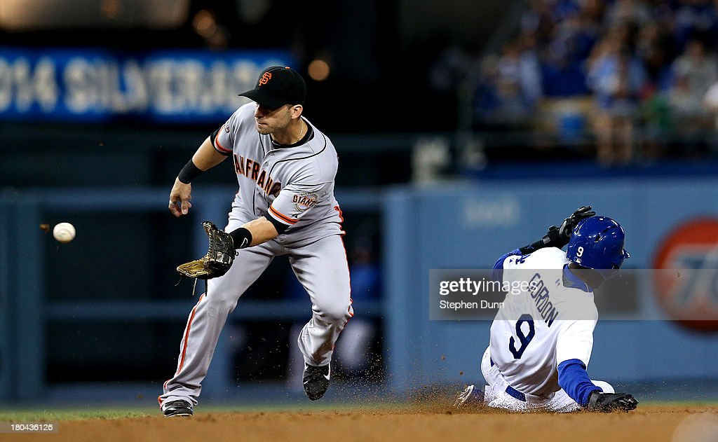 Pinch runner <a gi-track='captionPersonalityLinkClicked' href=/galleries/search?phrase=Dee+Gordon&family=editorial&specificpeople=7091343 ng-click='$event.stopPropagation()'>Dee Gordon</a> #9 of the Los Angeles Dodgers slides into second with a stolen base ahead of the throw to second baseman <a gi-track='captionPersonalityLinkClicked' href=/galleries/search?phrase=Marco+Scutaro&family=editorial&specificpeople=239523 ng-click='$event.stopPropagation()'>Marco Scutaro</a> #19 of the San Francisco Giants in the seventh inning at Dodger Stadium on September 12, 2013 in Los Angeles, California.