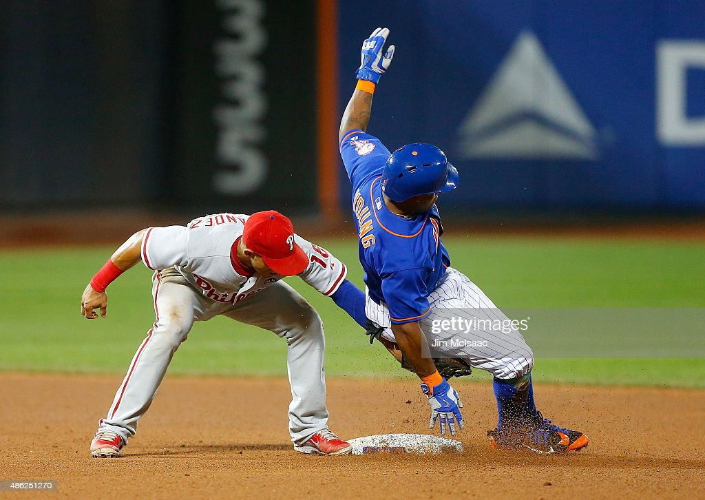 Pinch runner Eric Young Jr. #1 of the New York Mets is caught stealing second base in the seventh inning by Cesar Hernandez #16 of the Philadelphia Phillies at Citi Field on September 2, 2015 in the Flushing neighborhood of the Queens borough of New York City.