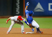 Pinch runner Eric Young Jr #1 of the New York Mets is caught stealing second base in the seventh inning by Cesar Hernandez of the Philadelphia...