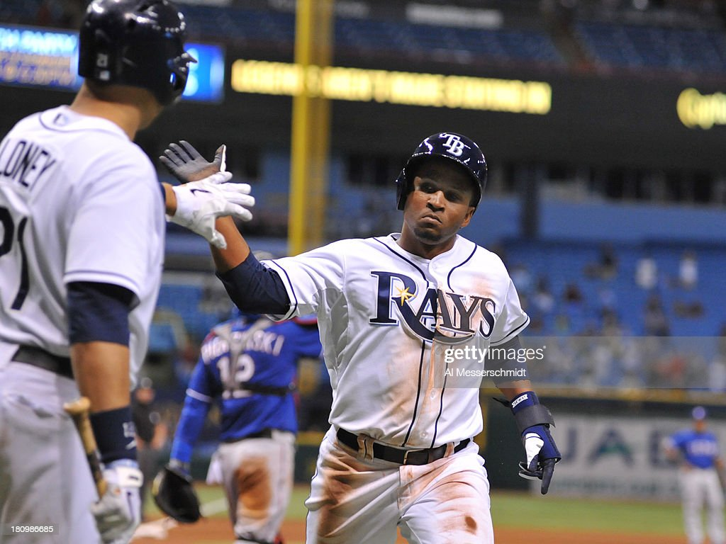 Pinch runner Freddy Guzman #43 of the Tampa Bay Rays celebrates after scoring the tying run in the 11th inning against the Texas Rangers September 18, 2013 at Tropicana Field in St. Petersburg, Florida. The Rays won 4 - 3.
