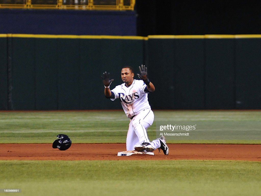 Pinch runner Freddy Guzman #43 of the Tampa Bay Rays steals 2nd base and later scores the tying run in the11th inning against the Texas Rangers September 18, 2013 at Tropicana Field in St. Petersburg, Florida. The Rays won 4 - 3.