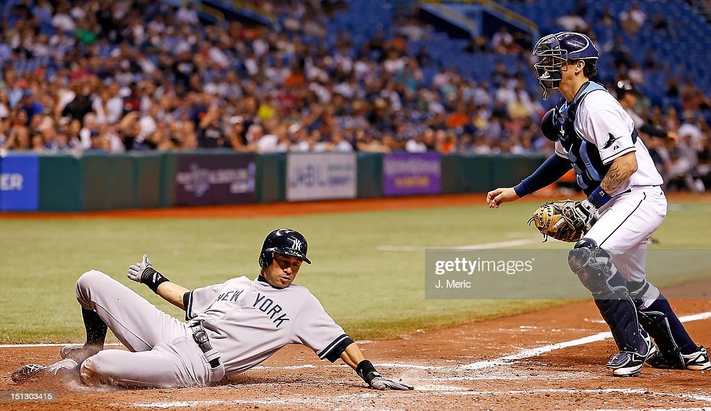 Pinch runner <a gi-track='captionPersonalityLinkClicked' href=/galleries/search?phrase=Ichiro+Suzuki&family=editorial&specificpeople=201556 ng-click='$event.stopPropagation()'>Ichiro Suzuki</a> #31 of the New York Yankees scores as catcher Jose Lobaton #21 of the Tampa Bay Rays looks on during the game at Tropicana Field on September 5, 2012 in St. Petersburg, Florida.