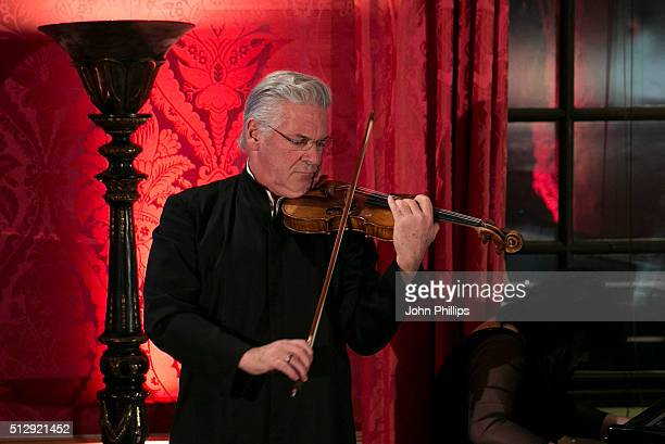 Pinchas Zukerman performs at the British Friends' Of The IPO 80th Anniversary Celebration at Kensington Palace on February 28 2016 in London England