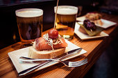 Pinchos or pintxos, traditional Basque Country appetizer. Served with beer