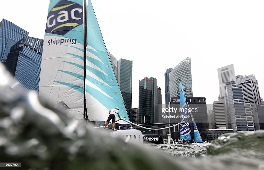 GAC Pindar (L) and The Wave Muscat compete during day one of the Extreme Sailing Series at Marina Bay Reservoir on April 11, 2013 in Singapore.