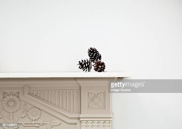 Pine cones on mantlepiece