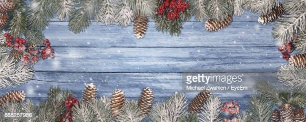 Pine Needles And Cones On Wooden Table