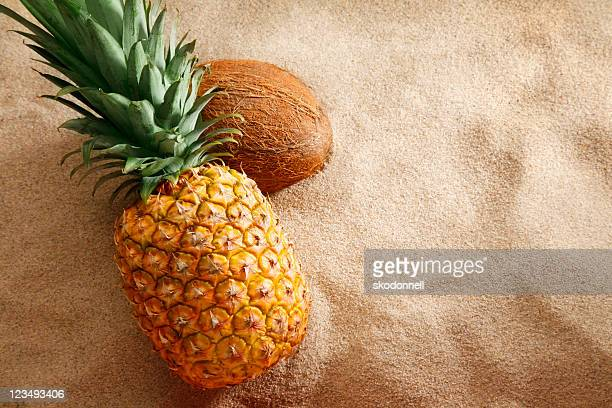 pineapple and coconut on the beach