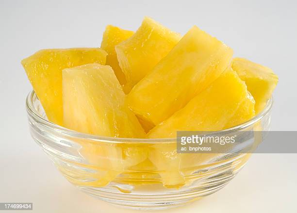 Pineapple chunks in a glass bowl