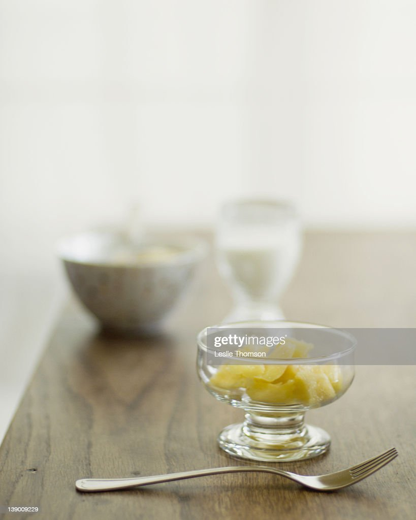 Pineapple chunks in clear bowl : Stock Photo