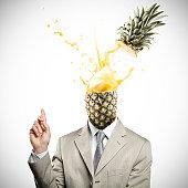 Pineapple headed businessman having an explosive idea